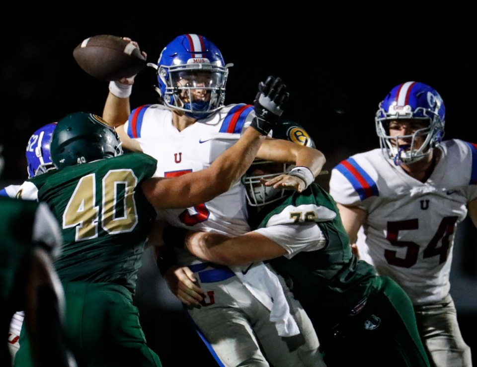<strong>MUS quarterback George Hamsley (middle) is sacked by Briarcrest on Friday, Oct. 1, 2021.</strong> (Mark Weber/The Daily Memphian)