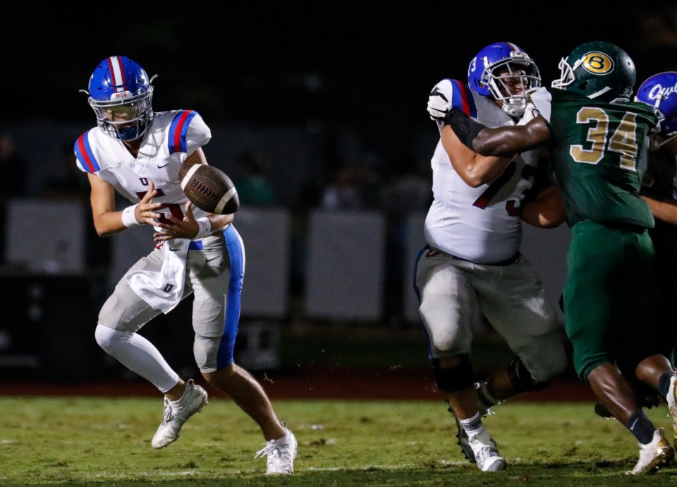 <strong>MUS quarterback George Hamsley (left) fumbles in the game against Briarcrest on Friday, Oct. 1, 2021.</strong> (Mark Weber/The Daily Memphian)