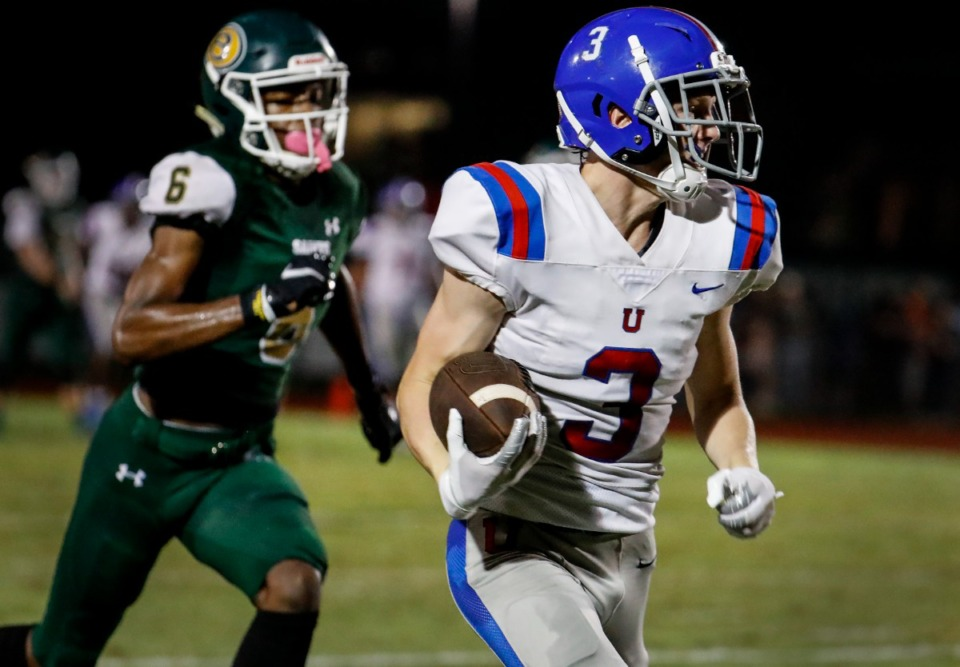 <strong>MUS receiver Mac Owen (right) makes a reception for a first down against Briarcrest&rsquo;s Devin Johnson (left) on Friday, Oct. 1, 2021.</strong> (Mark Weber/The Daily Memphian)