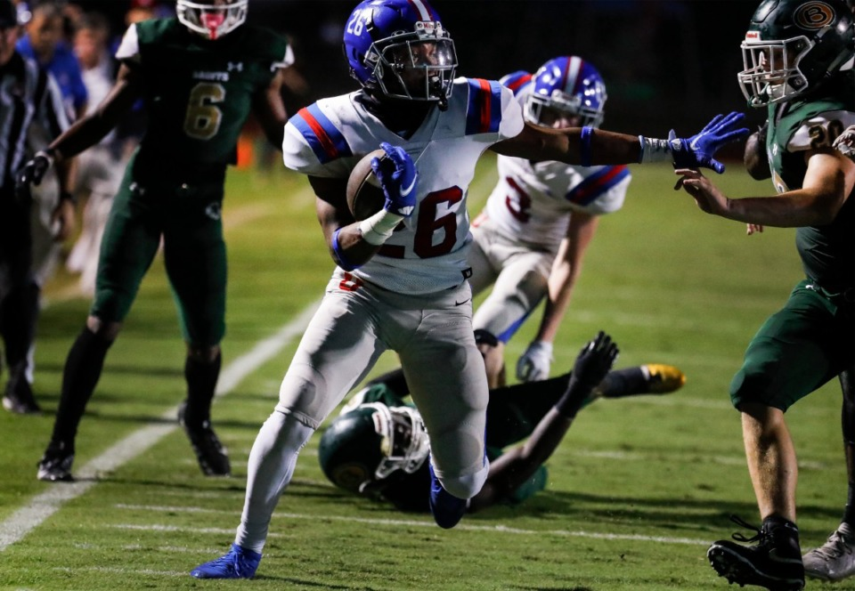 <strong>MUS running back Hunter Barnes (middle) scrambles for a first down against Briarcrest on Friday, Oct. 1, 2021.</strong> (Mark Weber/The Daily Memphian)