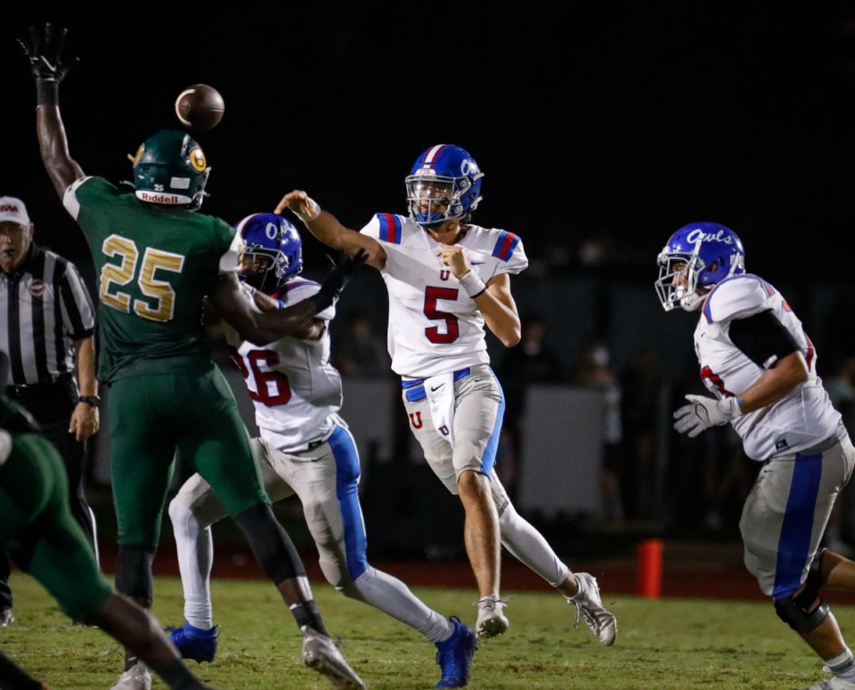 <strong>MUS quarterback George Hamsley (middle) passes against Briarcrest on Friday, Oct. 1, 2021.</strong> (Mark Weber/The Daily Memphian)