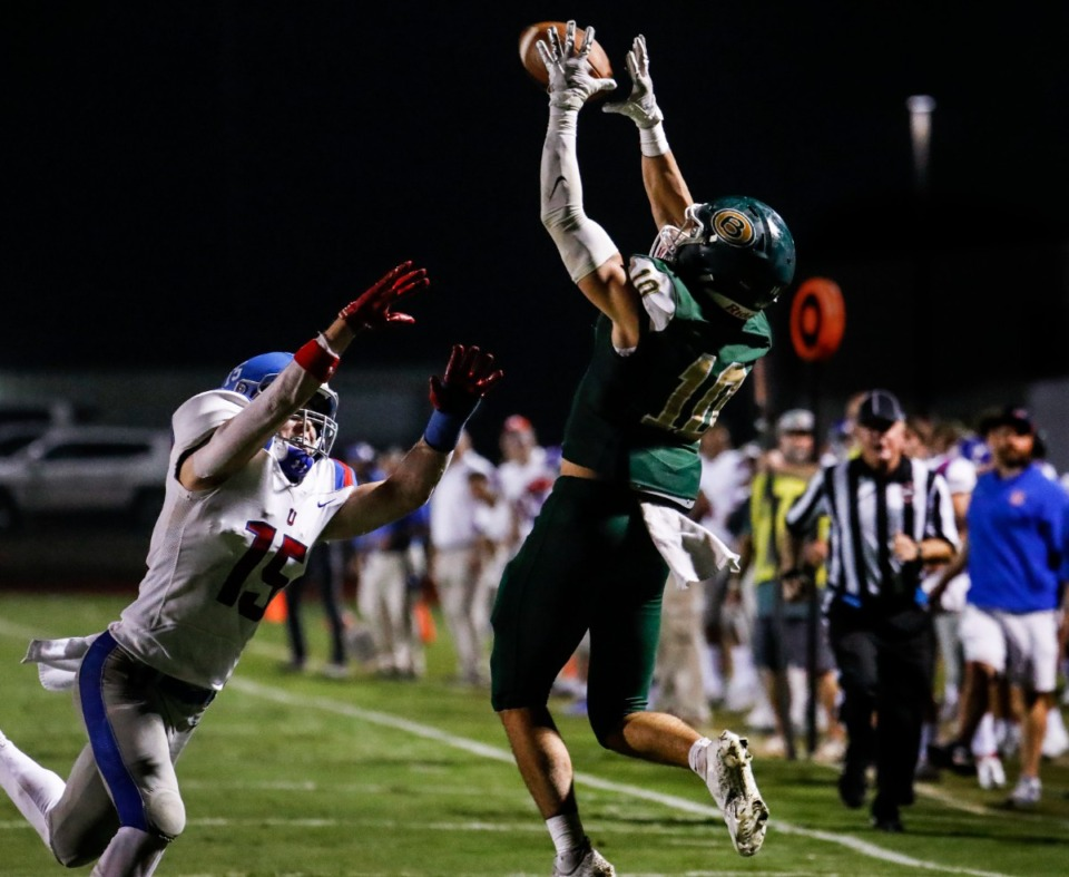 <strong>Briarcrest receiver Reed Linder (right) makes a reception despite MUS&rsquo; Hayes Wilkinson (left) on Friday, Oct. 1, 2021.</strong> (Mark Weber/The Daily Memphian)