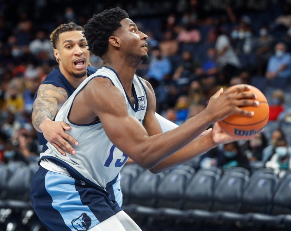<strong>Memphis Grizzlies center Jaren Jackson Jr. (right) drives the lane in front of teammate Brandon Clarke (left) during open practice on Sunday, Oct. 3, 2021.</strong> (Mark Weber/The Daily Memphian)