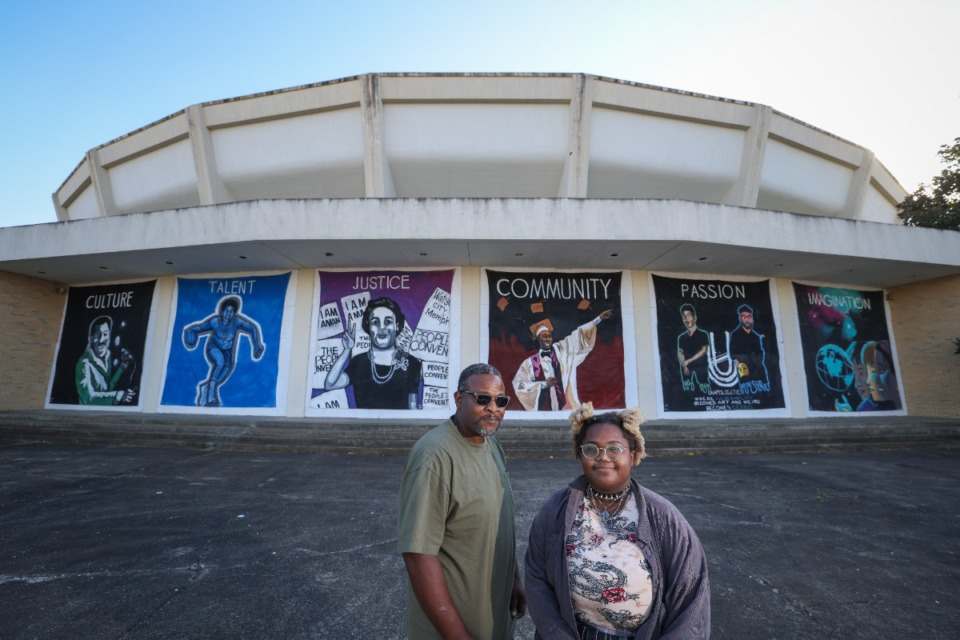 <strong>Theo James and his daughter Nisa Williams stand in front of a six-panel mural they painted in support of the revitalization of the Mid-South Coliseum.</strong> (Credit: Jamie Harmon)