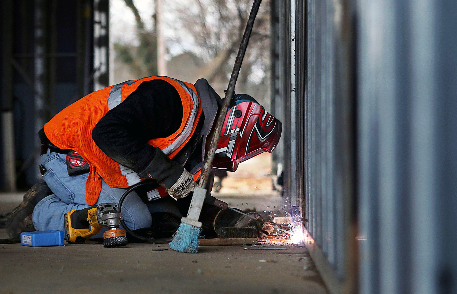 <strong>Daniel Gonzalez welds a piece of metal framing track to the floor of the TraVure hotel that is under construction in Germantown Thursday, Feb. 14. After a six-month delay, the hotel is back on track.</strong> (Patrick Lantrip/Daily Memphian)