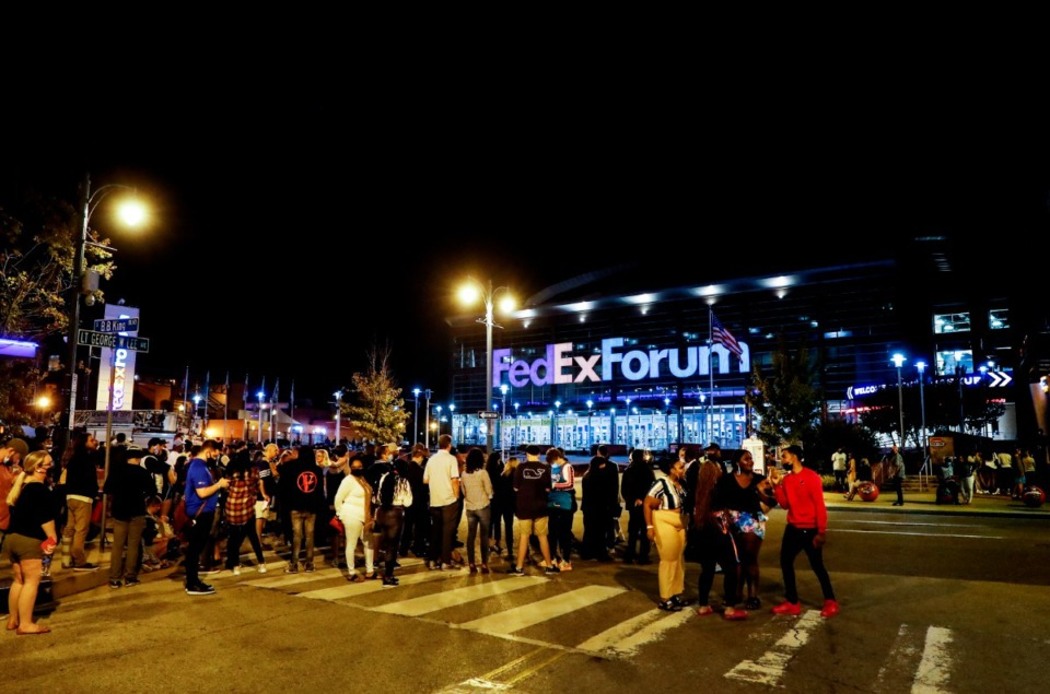 <strong>Memphis Grizzlies fans stand outside the FedExForum after a fire alarm stopped their preseason game against the Milwaukee Bucks at the end of the third quarter on Tuesday, Oct. 5, 2021.</strong> (Mark Weber/The Daily Memphian)