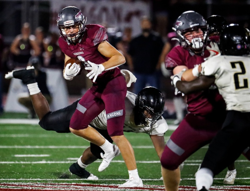 <strong>Collierville receiver Noah Flaskamp (left) scrambles for a first down against Whitehaven on Friday, Sept. 24, 2021. The Dragons will take a 7-0 record into the game Friday against Houston.</strong> (Mark Weber/The Daily Memphian file)