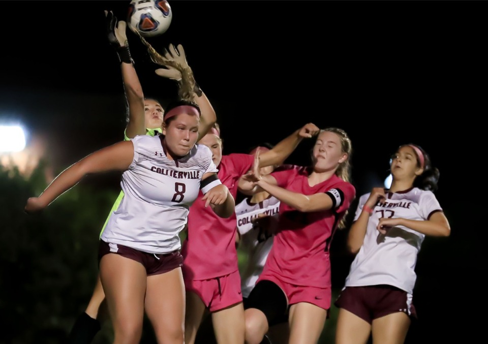 <strong>Collierville goalie Lily Reafsnyder (0) knocks the ball down after a corner kick during the Oct. 6, 2021, game against Houston.</strong> (Patrick Lantrip/Daily Memphian)