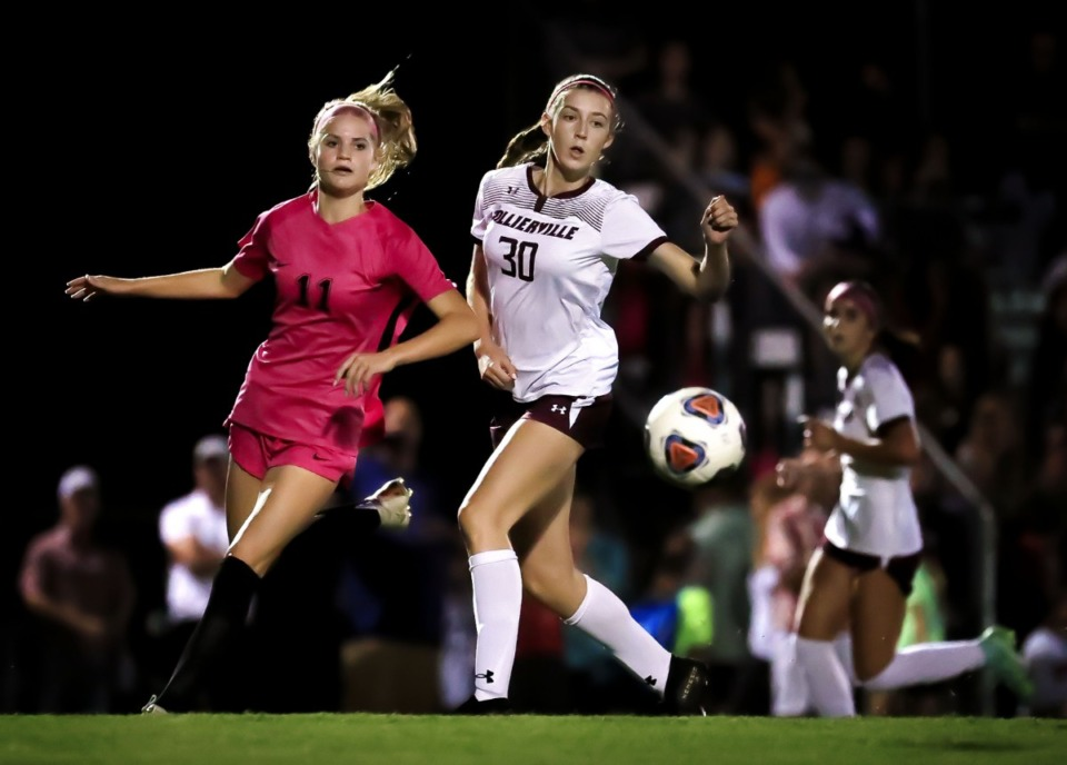 <strong>Houston midfielder Lucy Smith (11) battles against Collierville's Mckenzie Campbell (30) on Oct. 6, 2021.</strong> (Patrick Lantrip/Daily Memphian)