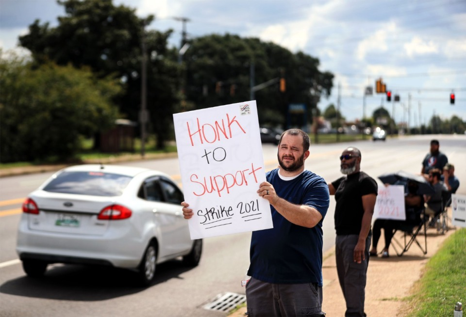 <strong>Thomas Collier (left) and Marvin Rush picket outside of Kellogg's South Memphis plant Oct. 5, 2021.</strong> (Patrick Lantrip/Daily Memphian)