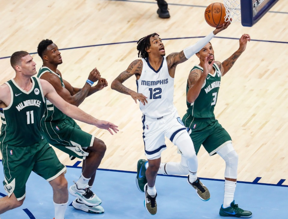 <strong>Memphis Grizzlies guard Ja Morant (middle) drives to the bucket on Oct. 5.&nbsp;Last season Morant averaged 19.1 points and 7.4 assists on .537 true shooting.</strong> (Mark Weber/The Daily Memphian)