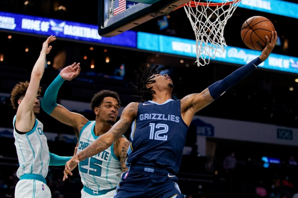 <strong>Memphis Grizzlies center Steven Adams, right, shoots despite Charlotte&rsquo;s guard LaMelo Ball, left, and forward P.J. Washington on Oct. 7, 2021, in Charlotte, North Carolina.</strong> (Chris Carlson/AP)