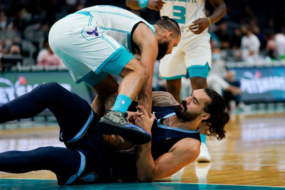 <strong>Charlotte forward Cody Martin and Memphis&rsquo; Steven Adams struggle to get possession of the ball</strong>&nbsp;<strong>on Oct. 7, 2021, in Charlotte, North Carolina.</strong> (Chris Carlson/AP)