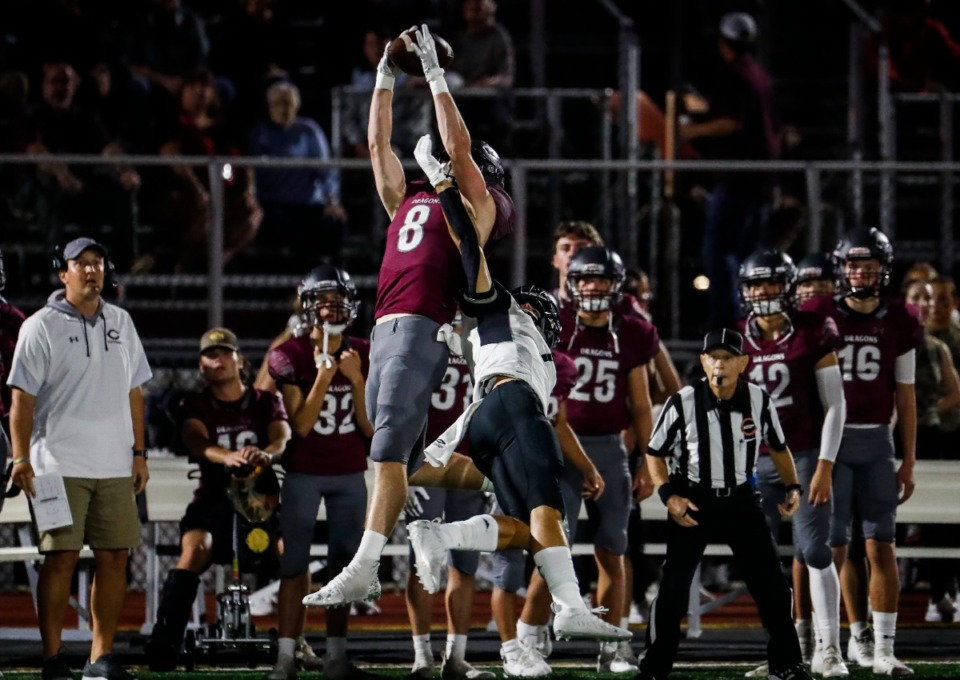 <strong>Collierville receiver Tyler Collier (middle) makes a reception for a first down against Houston on Oct. 7, 2021.</strong> (Mark Weber/The Daily Memphian)