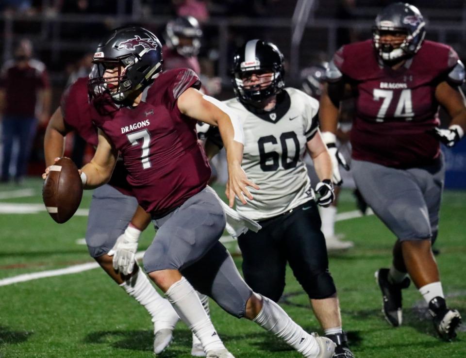 <strong>Collierville quarterback Houston Wilhelm (left) rushes against Houston on Thursday, Oct. 7, 2021.</strong> (Mark Weber/The Daily Memphian)