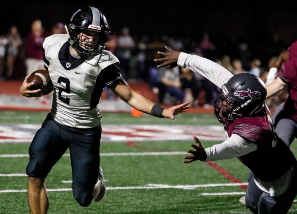 <strong>Houston running back Ben Stegall (left) evades the Collierville defense on Oct. 7, 2021.</strong> (Mark Weber/The Daily Memphian)