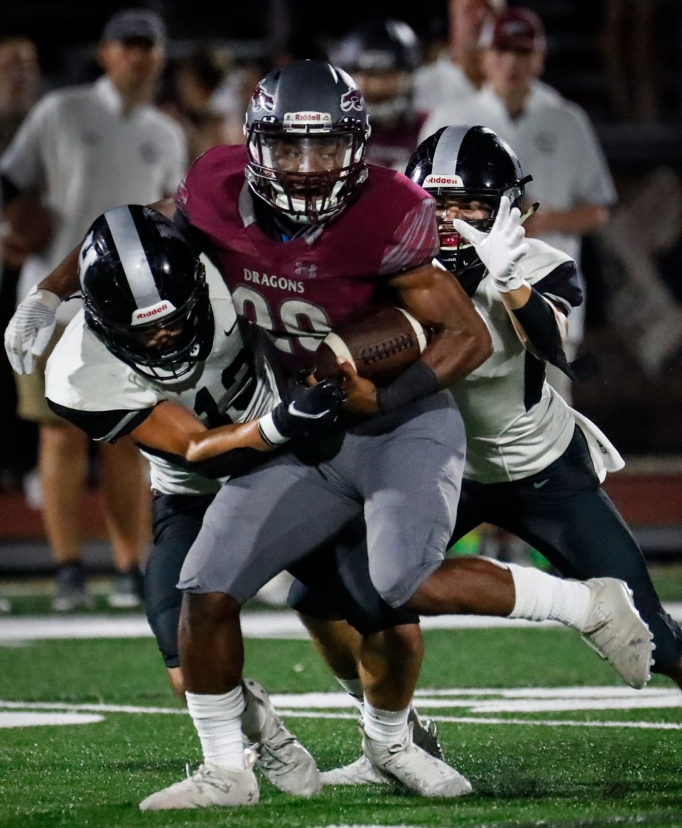 <strong>Collierville running back Troy Martin is tackled for a loss in the game against Houston on Oct. 7, 2021.</strong> (Mark Weber/The Daily Memphian)