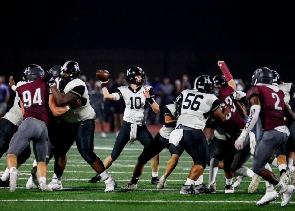<strong>Houston quarterback Jeremiah Salem (middle) passes in the game against Collierville on Oct. 7, 2021.</strong> (Mark Weber/The Daily Memphian)