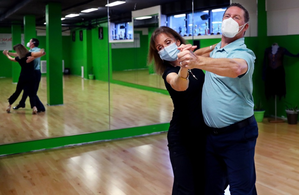 <strong>Lisa Hord and Benji Smith demonstrate their moves at DanceSmiths Ballroom Dance Studio's East Memphis location, which features the same beech flooring that was recently installed on the &ldquo;Dancing with the Stars&rdquo; dancefloor.</strong> (Patrick Lantrip/Daily Memphian)