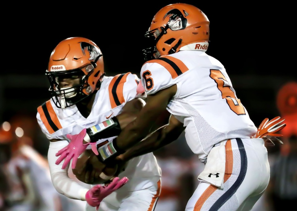 <strong>Ridgeway High School quarterback Jeremiah Lucas (6) hands the ball off to running back Quintarrius Ayers (4) during the Oct. 8, 2021, game against Kirby High School.</strong> (Patrick Lantrip/Daily Memphian)