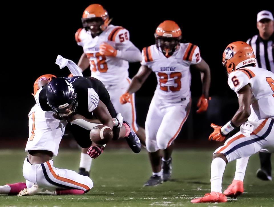 <strong>Kirby High School quarterback Jamariyan Farmer (8) gets the ball knocked out by a Ridgeway High School defender during the Oct. 8, 2021, game.</strong> (Patrick Lantrip/Daily Memphian)