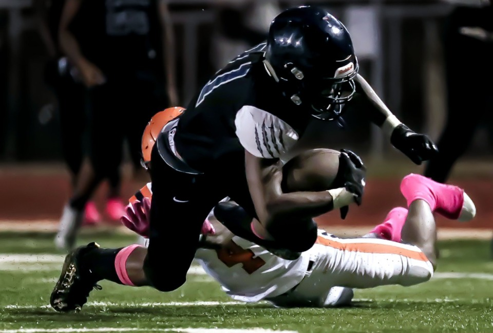 <strong>Kirby High School quarterback Kam Hall (11) gets brought down by a Ridgeway High School defender in the Oct. 8, 2021, game.</strong> (Patrick Lantrip/Daily Memphian)