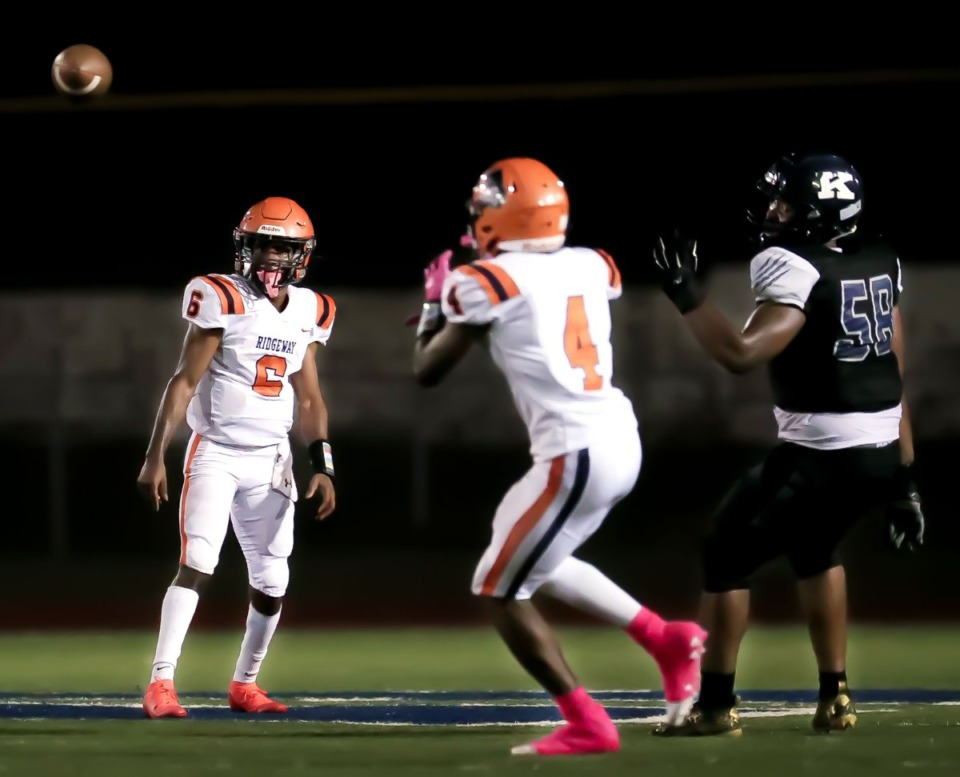 <strong>Ridgeway High School quarterback Jeremiah Lucas (6) throws the ball to running back Quintarrius Ayers (4) during the Oct. 8, 2021, game against Kirby High School.</strong> (Patrick Lantrip/Daily Memphian)