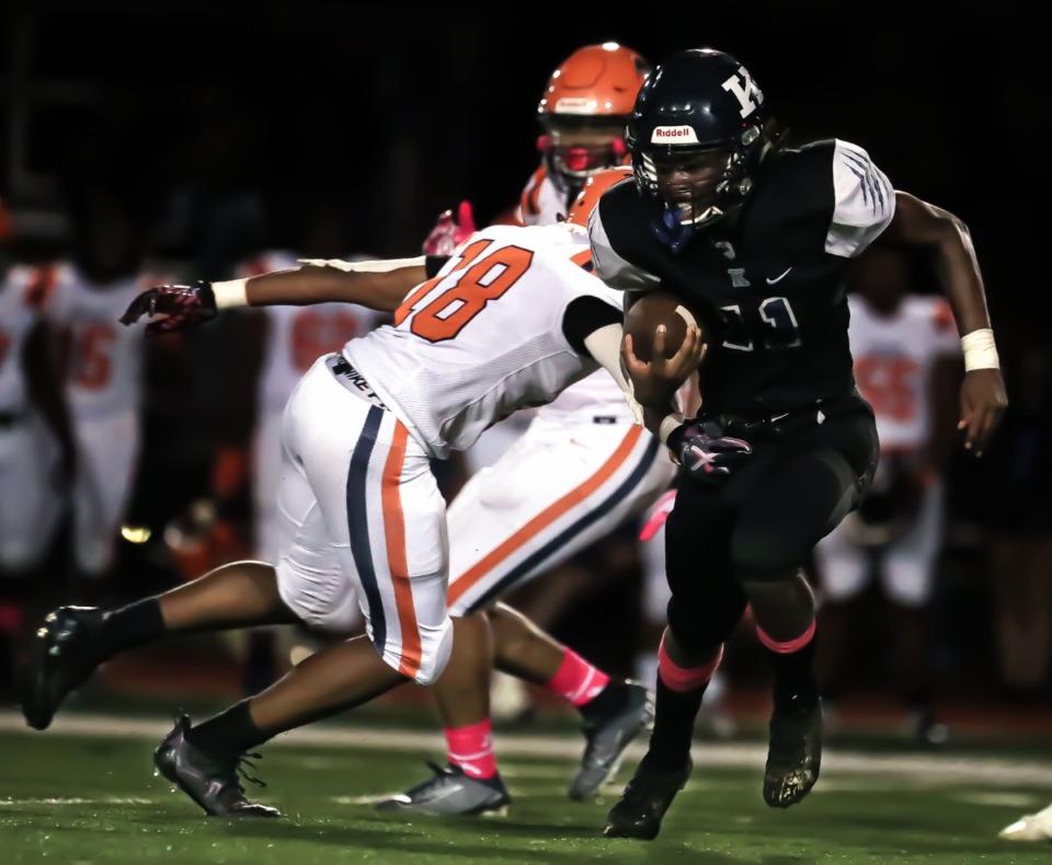 <strong>Kirby High School quarterback Kam Hall (11) runs past a Ridgeway High School defender during the Oct. 8, 2021, game.</strong> (Patrick Lantrip/Daily Memphian)