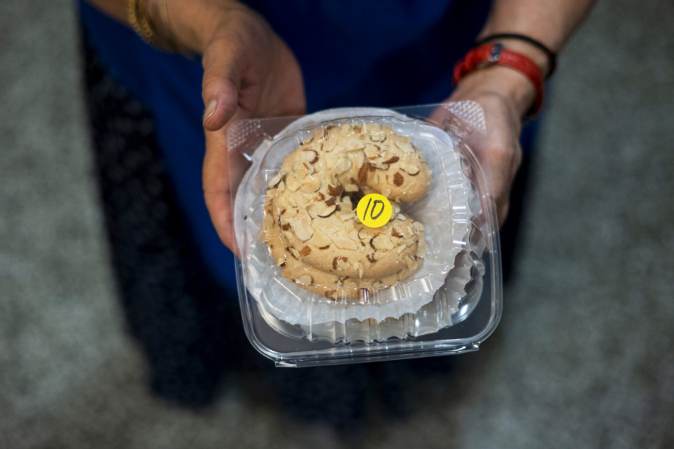 <strong>Despina Karas shows off a ergolavi, a Greek almond cookie, during the Memphis Greek Festival at Annunciation Greek Orthodox Church.</strong> (Brad Vest/Special to Daily Memphian)
