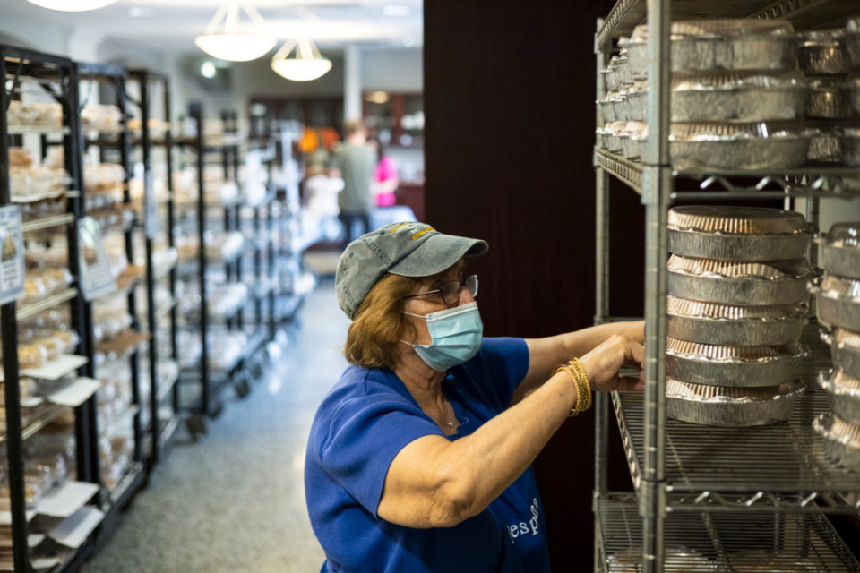 <strong>Despina Karas restocks different Greek pastries during the Memphis Greek Festival at Annunciation Greek Orthodox Church.</strong> (Brad Vest/Special to Daily Memphian)