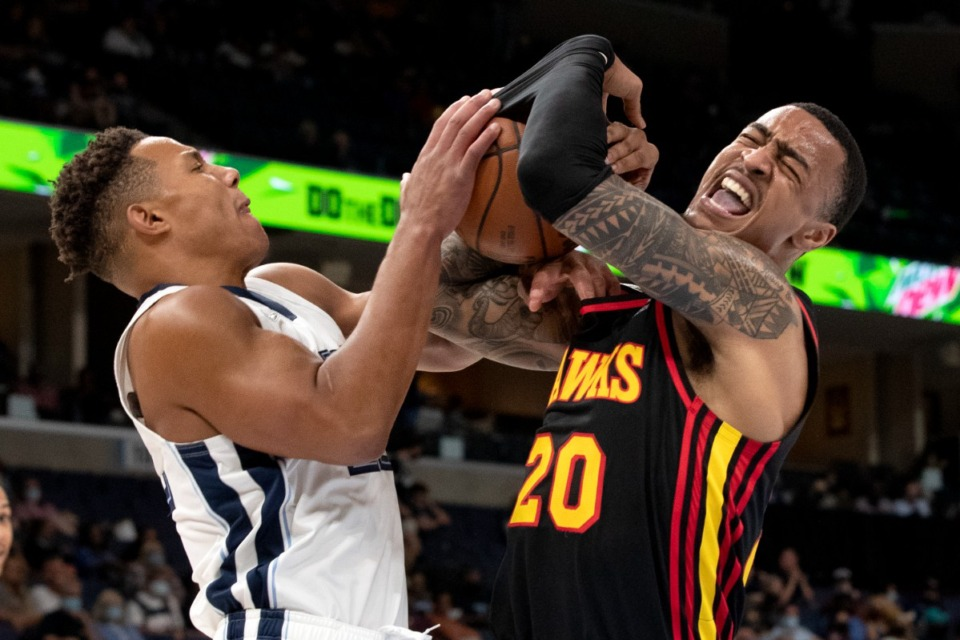 <strong>Memphis Grizzlies guard Desmond Bane (left) tangles up Atlanta Hawks forward John Collins resulting in a jump ball in the first half of the preseason game Saturday, Oct. 9, at FedExForum.</strong>&nbsp;<strong>The Grizzlies lost, 91-87.</strong> (Nikki Boertman/Associated Press)