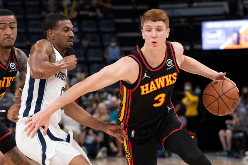 <strong>Atlanta Hawks guard Kevin Huerter drives to the basket against the defense of Memphis Grizzlies guard De'Anthony Melton (left) in the first half at FedExForum on Saturday, Oct. 9.</strong> (Nikki Boertman/Associated Press)