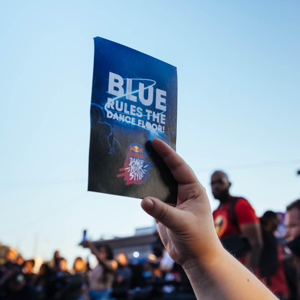 <strong>Audience members vote with either red or blue cards to cast ballots for their favorite competitors in Red Bull's Dance Your Style at Railgarten on Sunday, Oct. 10, 2021.</strong> (Ziggy Mack/Special to The Daily Memphian)