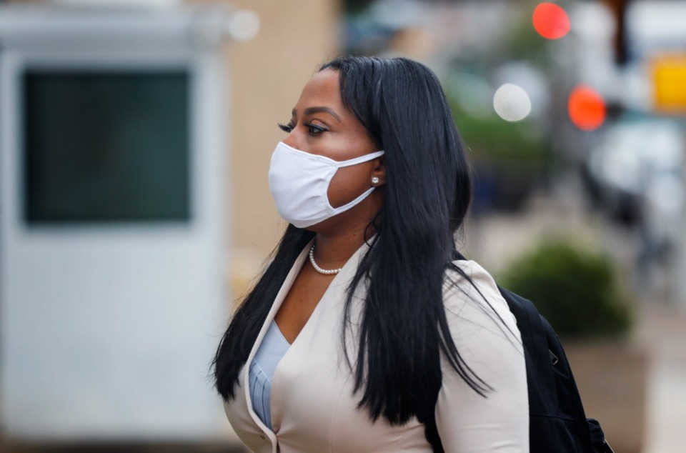 <strong>State Sen. Katrina Robinson (walking to federal court on Sept. 17) was found guilty of four counts of wire fraud last month.</strong> (Mark Weber/Daily Memphian)