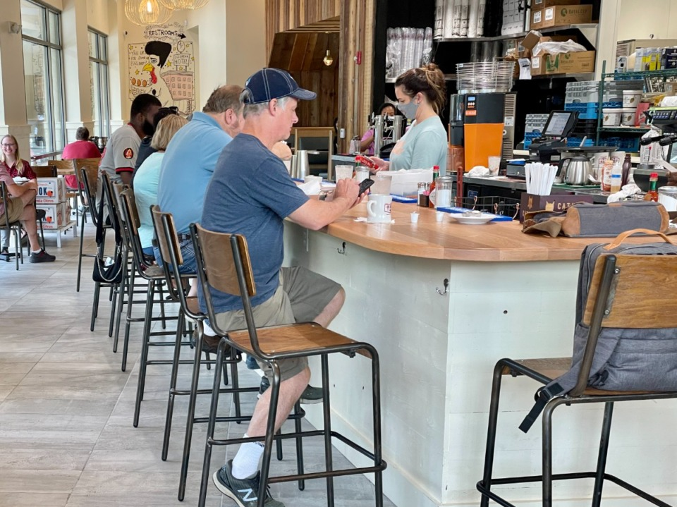 <strong>A large bar in the center of Big Bad Breakfast in East Memphis feels like a diner counter.</strong> (Jennifer Biggs/Daily Memphian)