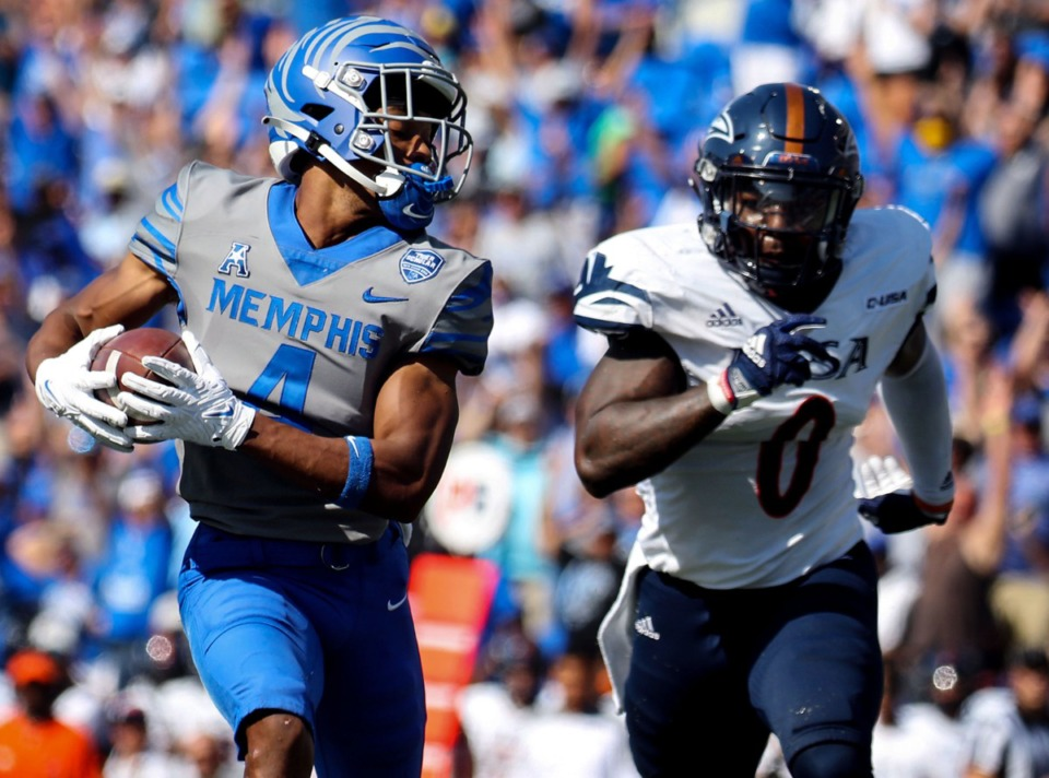 <strong>University of Memphis receiver Calvin Austin III (4) scrambles for a first down while being chased by University of Texas San Antonio safety Rashad Wisdom during the Sept. 25 game at the Liberty Bowl Memorial Stadium.</strong> (Patrick Lantrip/Daily Memphian)