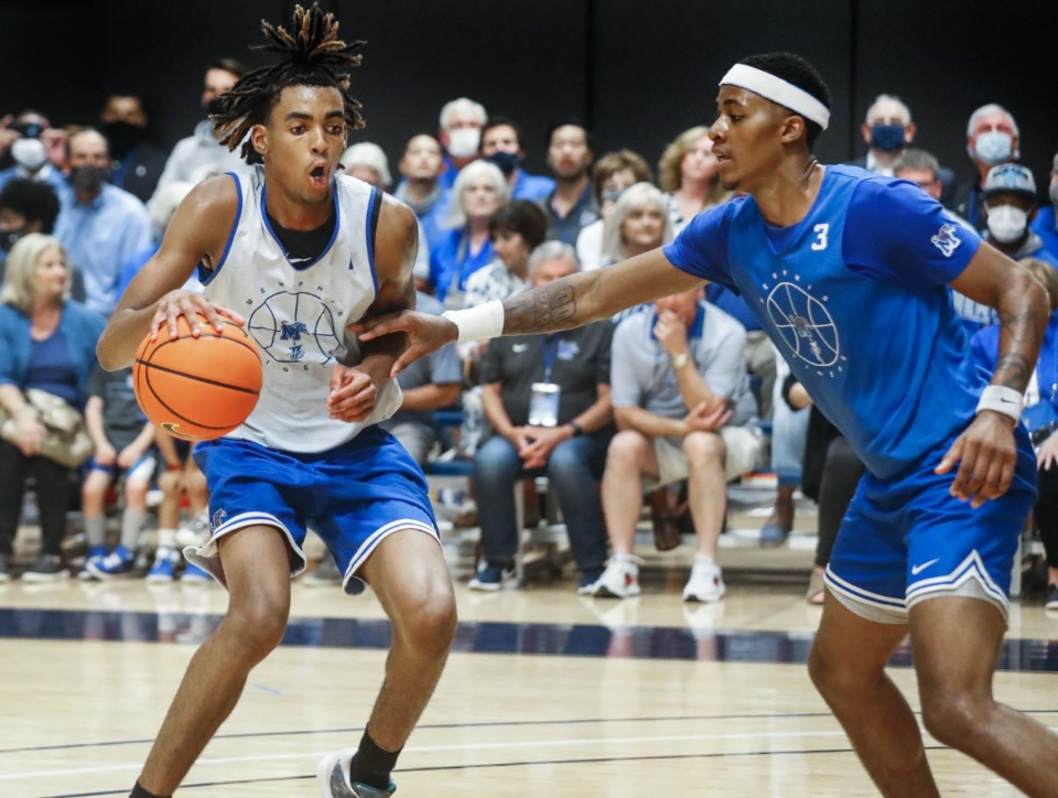 <strong>An NCAA postseason would dampen what promises to be an electric season for Tigers like forward Emoni Bates (left, in September) and Landers Nolley II (right).</strong> (Mark Weber/The Daily Memphian file)