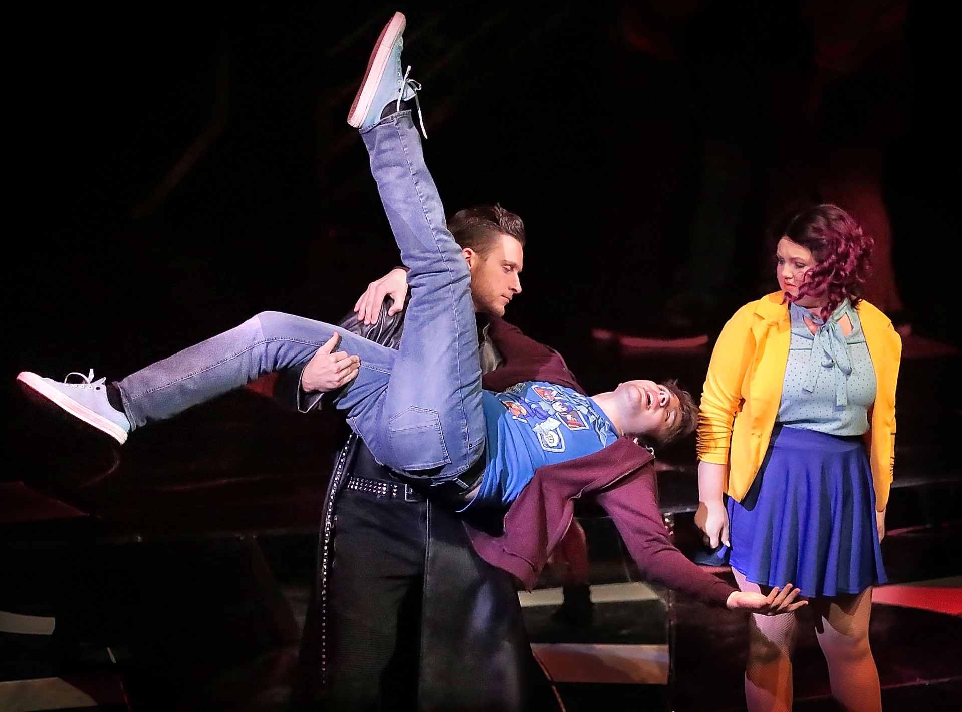"""<strong>Toby Davis (center), playing Jeremy, makes a desperate bid for popularity with the help of Landon Ricker (left) during a performance of the musical """"Be More Chill"""" by the University of Memphis Department of Theatre and Dance on Feb. 15, 2019, for area high school students. The musical premiered on Broadway on Feb. 13.&nbsp;</strong>&nbsp;(Jim Weber/Daily Memphian)"""