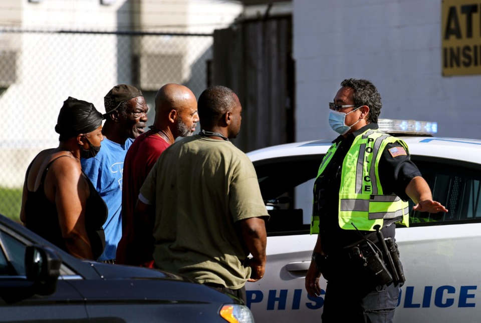 <strong>Memphis Police Department officers talk to residents of Orange Mound after a shooting at a nearby postal facility Oct. 12, 2021.</strong> (Patrick Lantrip/Daily Memphian)