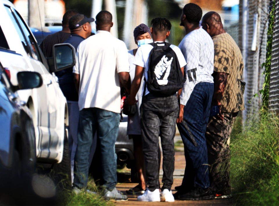<strong>Family members of victims and employees pray outside of a postal facility in Orange Mound after a shooting Oct. 12, 2021. </strong>(Patrick Lantrip/Daily Memphian)