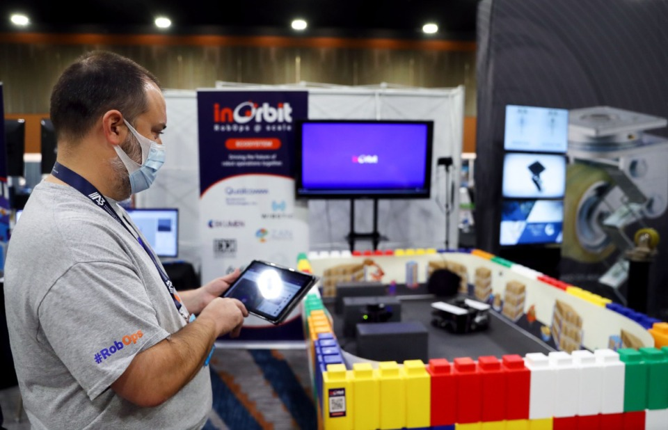 <strong>InOrbit Inc. products director John Simmons operates a scale model warehouse robot at the Renasant Convention Center on Oct. 12.</strong> (Patrick Lantrip/Daily Memphian)