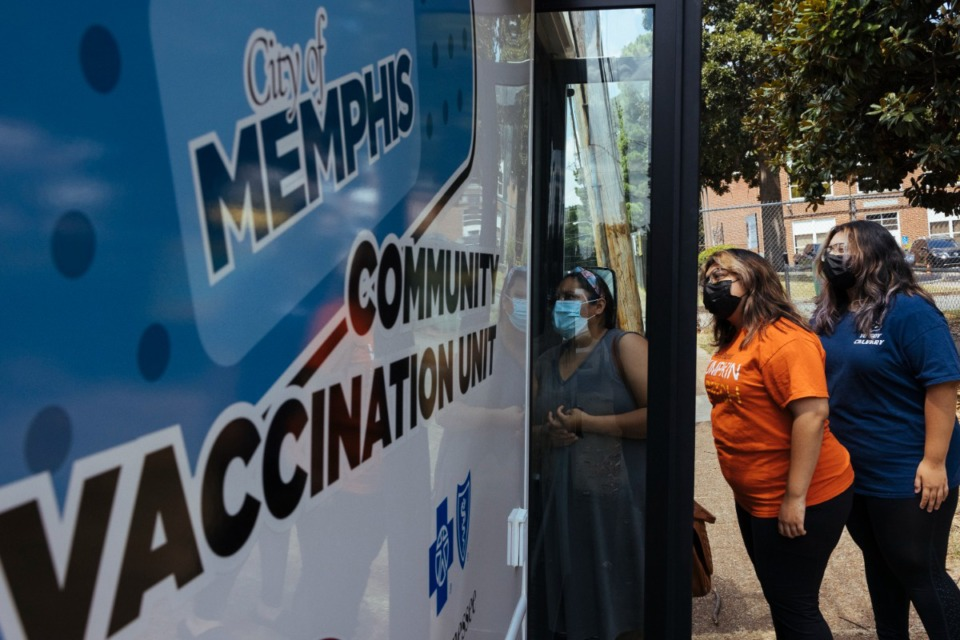 <strong>Members of the Gonzales family mother Aracely (left), Areli and Andrea enter the mobile community vaccination unit to receive their choice of COVID vaccine at Carpenter Art Garden in Binghampton on Thursday, Aug. 12, 2021.</strong> (Ziggy Mack/Special to The Daily Memphian)