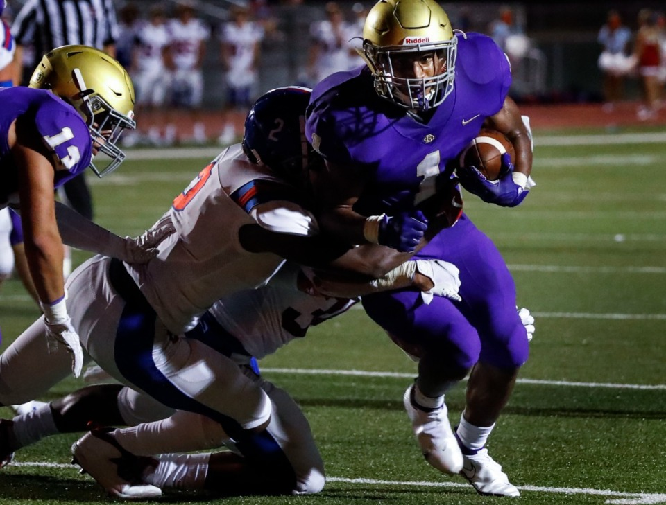 <strong>CBHS running back Dallan Hayden (right) scrambles past the MUS defense for a first down during action in their high school football game on Friday, Sept. 4, 2020.</strong> (Daily Memphian file)