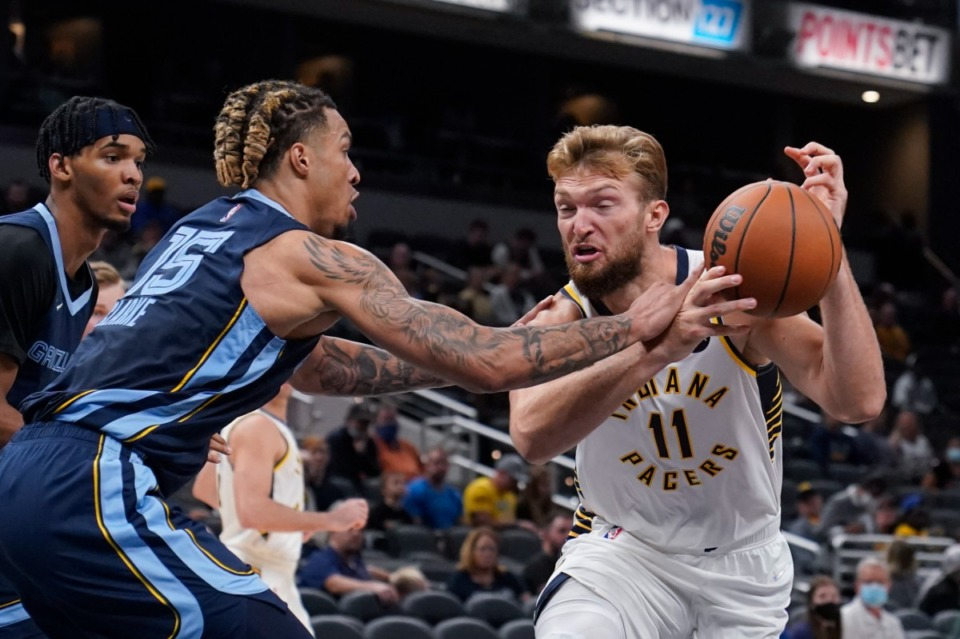 <strong>Grizzlies' Brandon Clarke (15) tries to keep Indiana&rsquo;s Domantas Sabonis (11) away from the basket on Oct. 13 in Indianapolis.</strong> (Darron Cummings/AP)