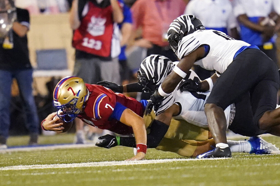 <strong>Tulsa quarterback Davis Brin (7) is tackled by Memphis defensive back Quindell Johnson, center, and linebacker Thomas Pickens during the second half of an NCAA college football game Saturday, Oct. 9, 2021, in Tulsa, Okla.</strong> (AP Photo/Sue Ogrocki)