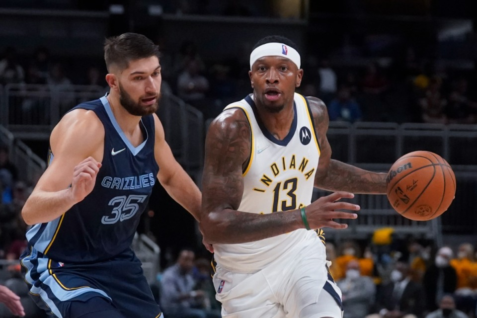 <strong>Grizzlies' Killian Tillie (35) defends against Indiana&rsquo;s Torrey Craig (13) on Oct. 13 in Indianapolis.</strong> (/Darron Cummings/AP)
