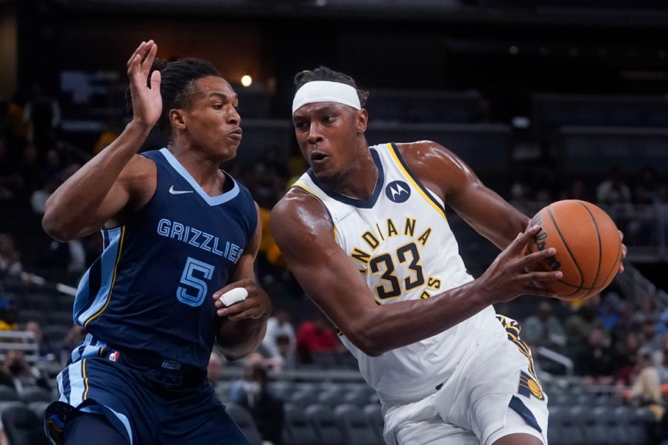 <strong>Indiana Pacers' Myles Turner (33) triers to go around the Grizzlies' Yves Pons (5) on Oct. 13 in Indianapolis.</strong> (Darron Cummings/AP)