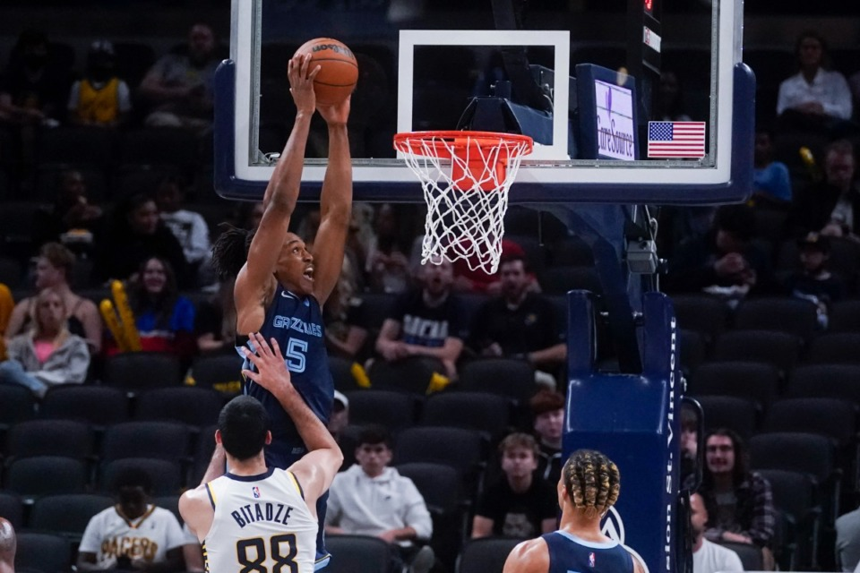<strong>The Grizzlies' Yves Pons (5) dunks next to Indiana&rsquo;s Goga Bitadze (88) on Oct. 13 in Indianapolis.</strong> (Darron Cummings/AP)