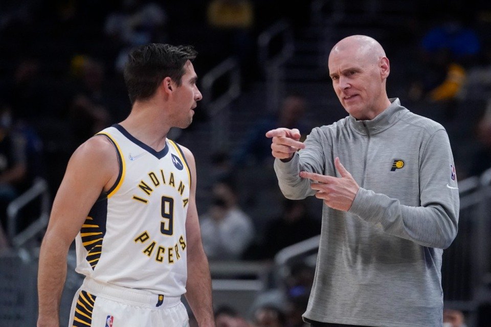 <strong>Indiana head coach Rick Carlisle instructs T.J. McConnellin the game against Memphis on Oct. 13 in Indianapolis.</strong> (Darron Cummings/AP)
