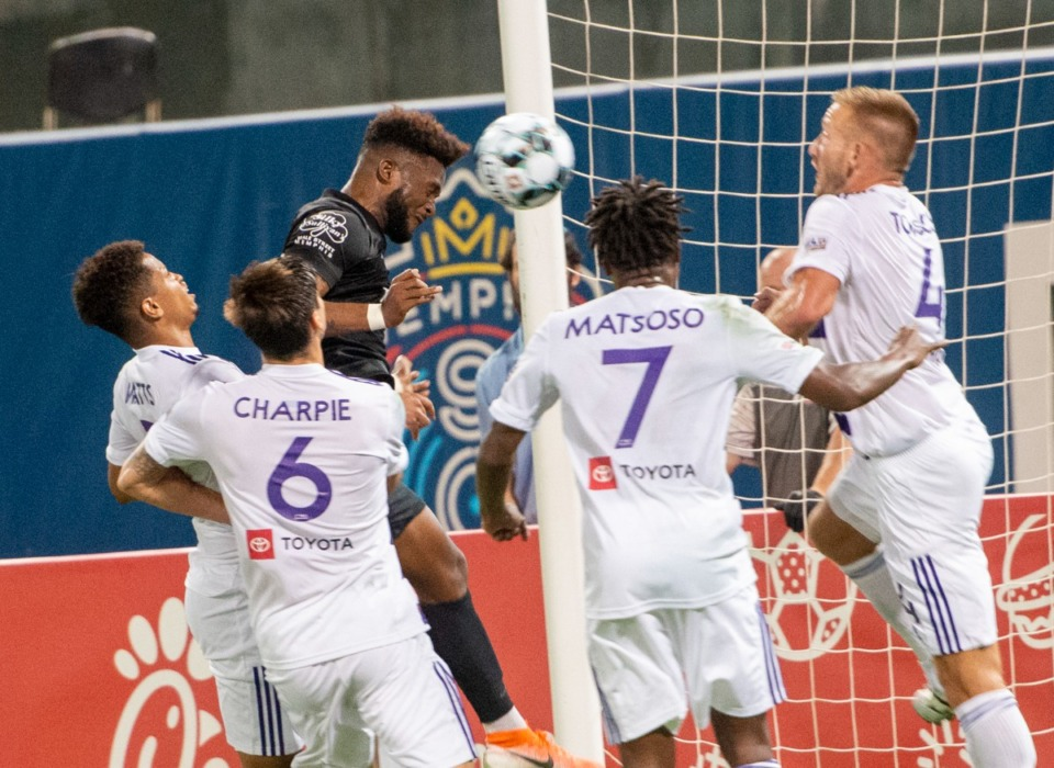 <strong>Michael Salazar scores late in the first half against a host of Louisville City FC defenders. Memphis won the contest 2-1 in Memphis.</strong> (Greg Campbell/Special to The Daily Memphian)